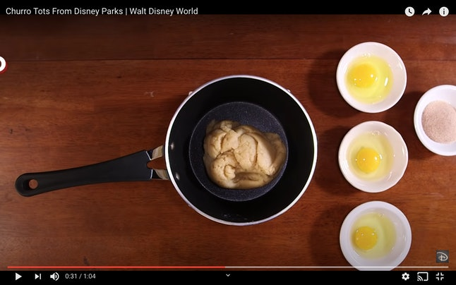 Add in eggs one at a time in the next step of the Disney churro bites recipe.