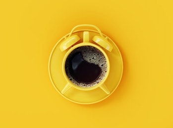 Coffee clock on yellow background. creative idea. minimal concept