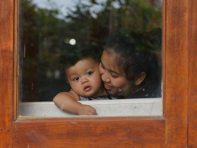a mother in window with child