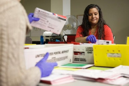 Election workers sort mailed-in ballots in Washington state on March 10.