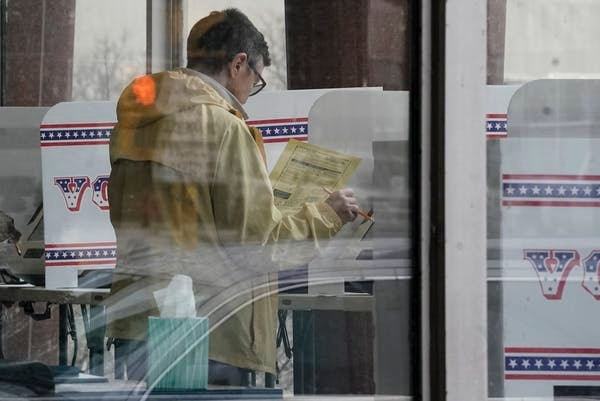 A Wisconsin voter casts a ballot ahead of primary election day, avoiding lines and finding a more convenient time to vote.
