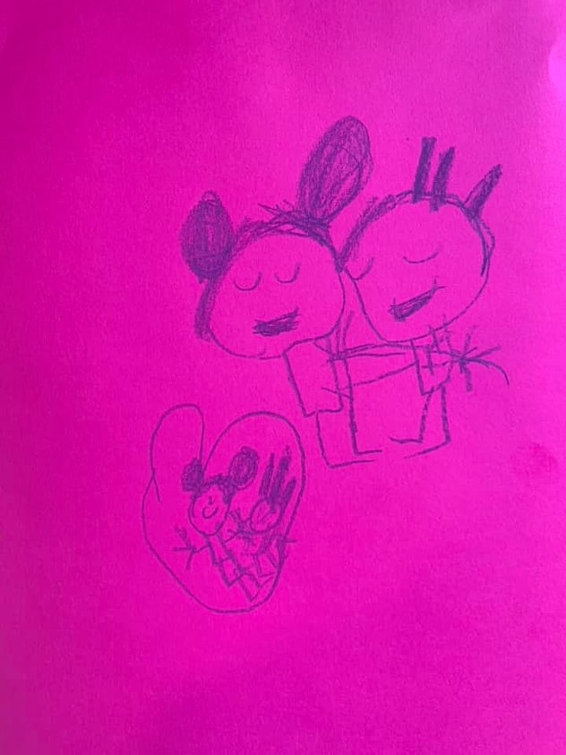 Child's drawing of two figures hugging and a heart.
