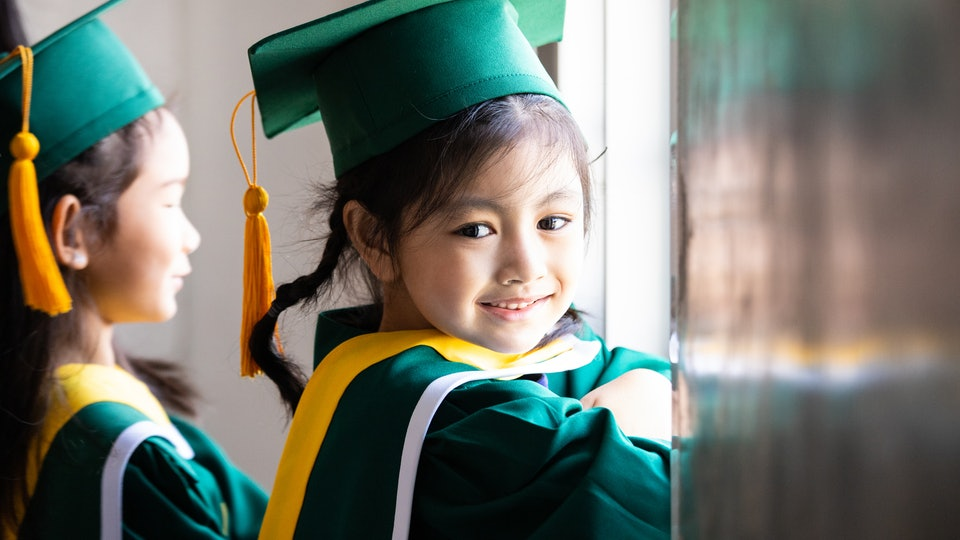A kindergartener at her class graduation