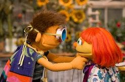 Sesame Street's Julia and her big brother Sam, dressed up as superheroes