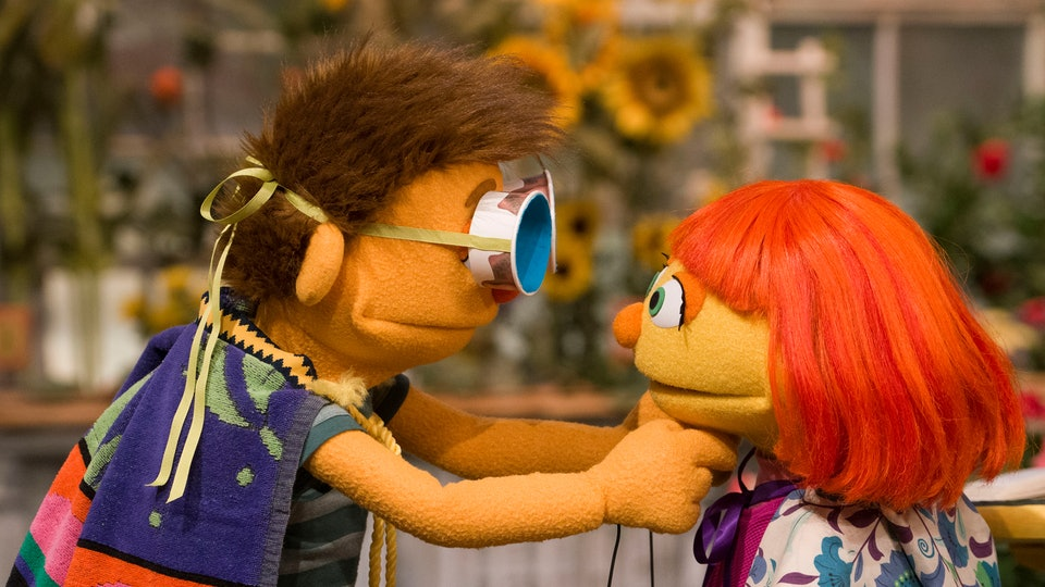 Sesame Street's Julia and her big brother Sam, dressed up as superheroes