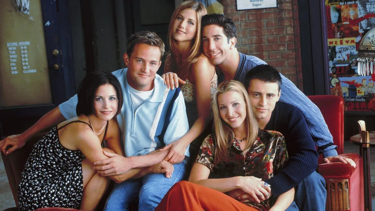 cast of friends on a couch