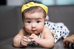 baby girl lying on stomach