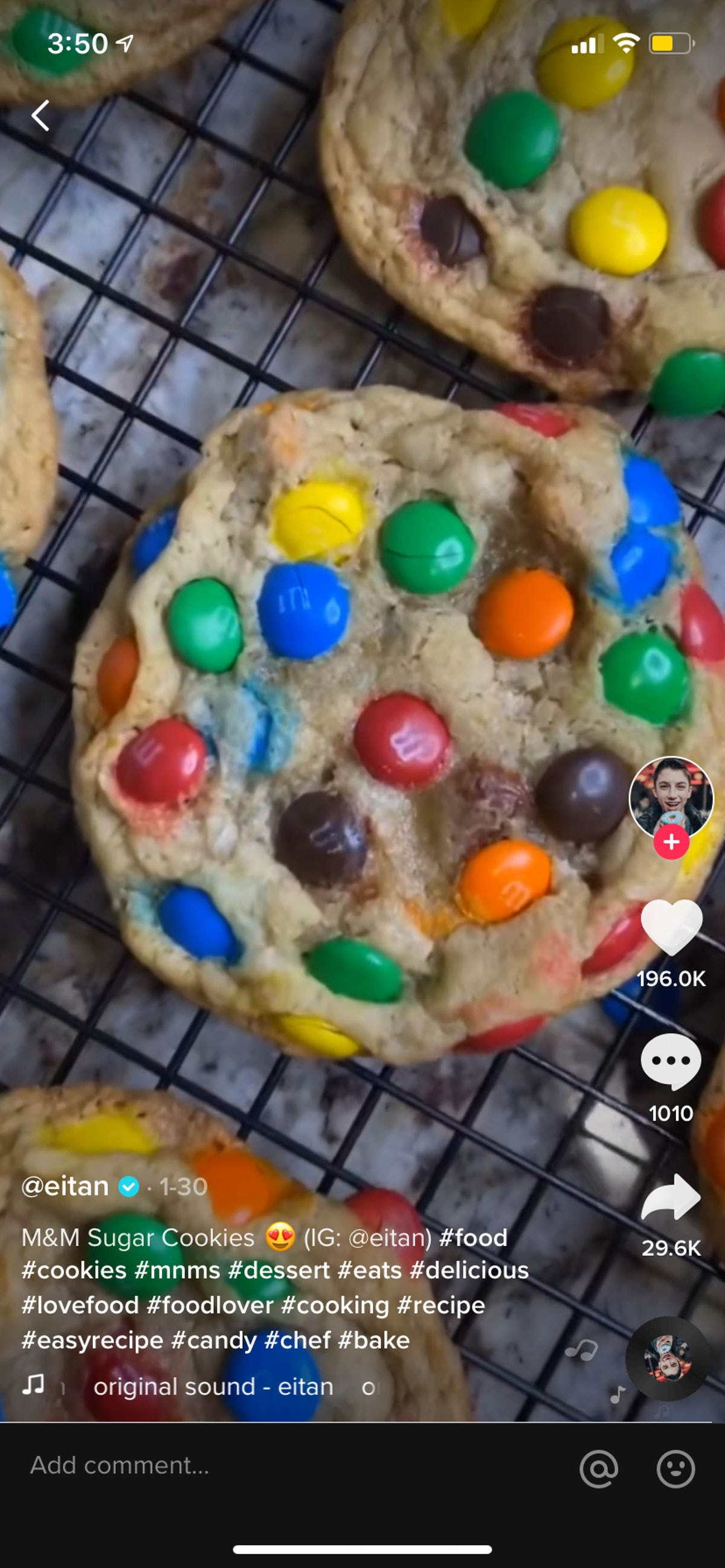 M&M sugar cookies sit on a cooling rack in a TikTok video.