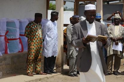 A man prays for Muslim Ebola victims at a crematorium in Monrovia, Liberia, March 2015.