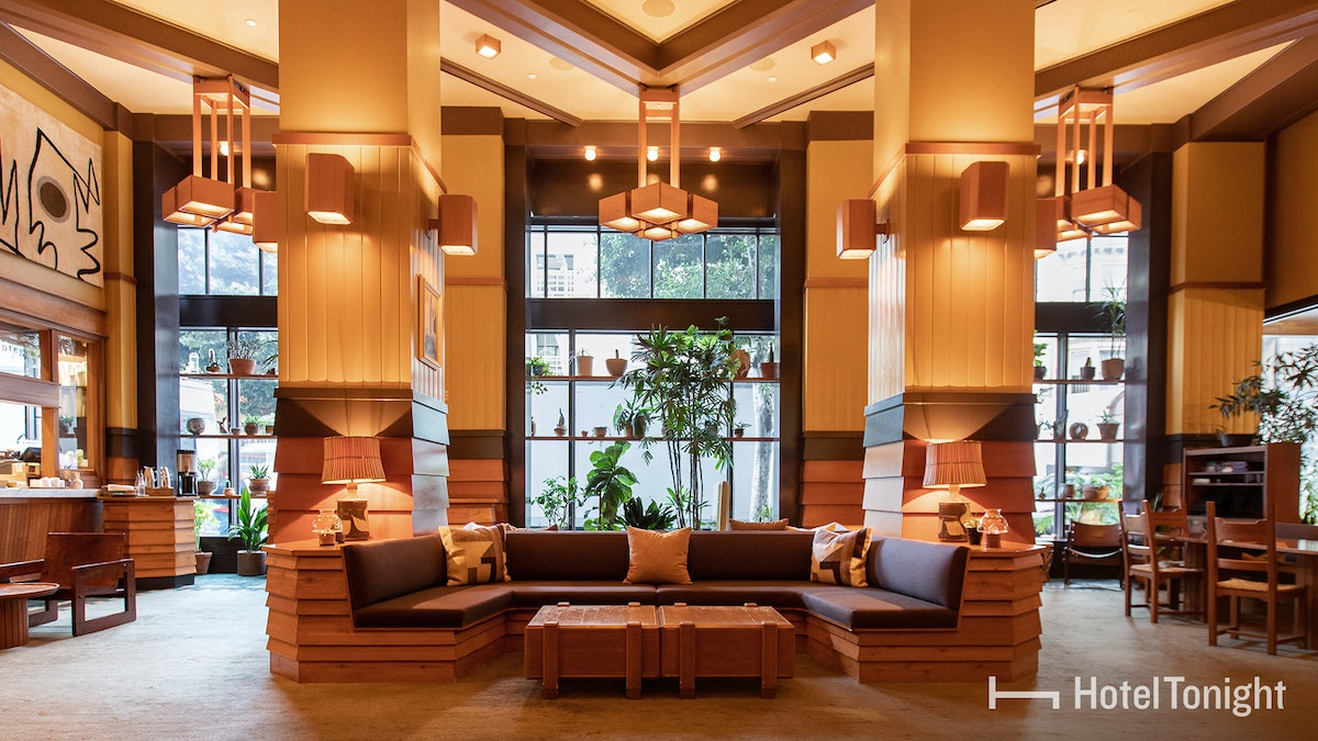 A high-end lobby in a Los Angeles hotel has dim lighting and lots of wood detailing.