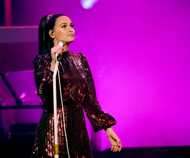 Kacey Musgraves wears a ponytail while performing.