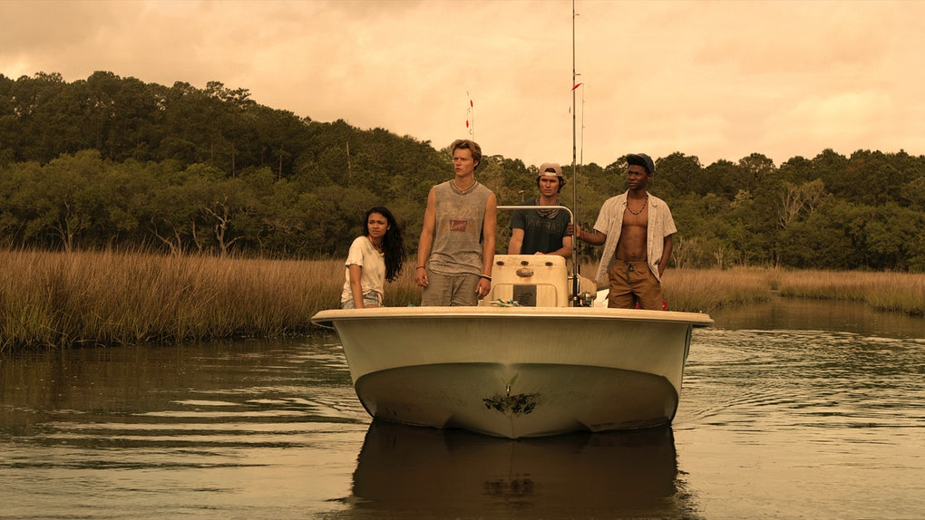 The cast of 'Outer Banks' on Netflix rides a boat