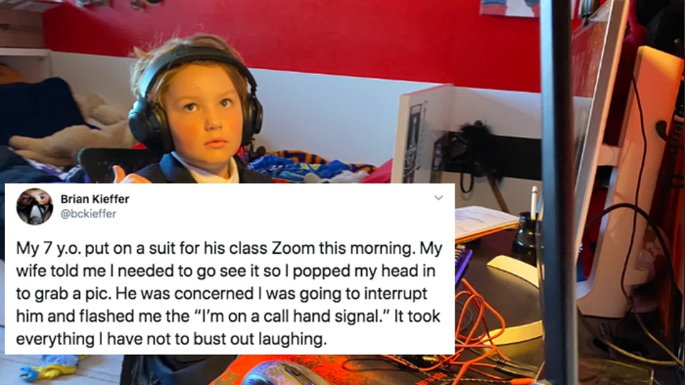 A young boy has charmed Twitter by wearing a suit for his Zoom class.