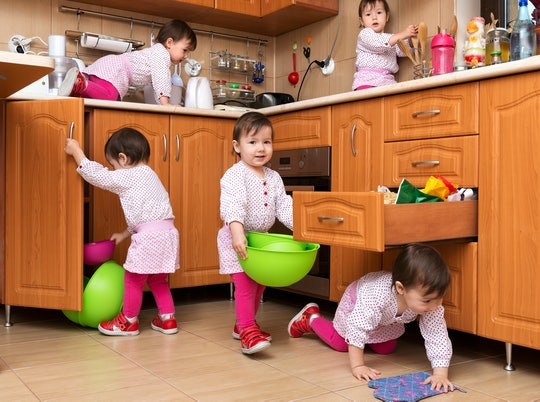 little girl playing in a kitchen, shown multiple times!