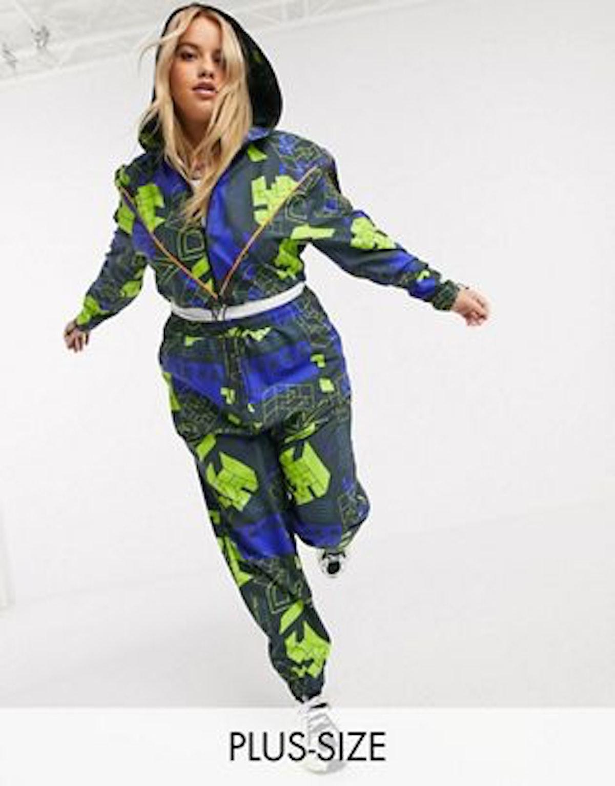 COLLUSION Plus Exclusive Trekka Print Nylon Sweatpants And Crop Jacket