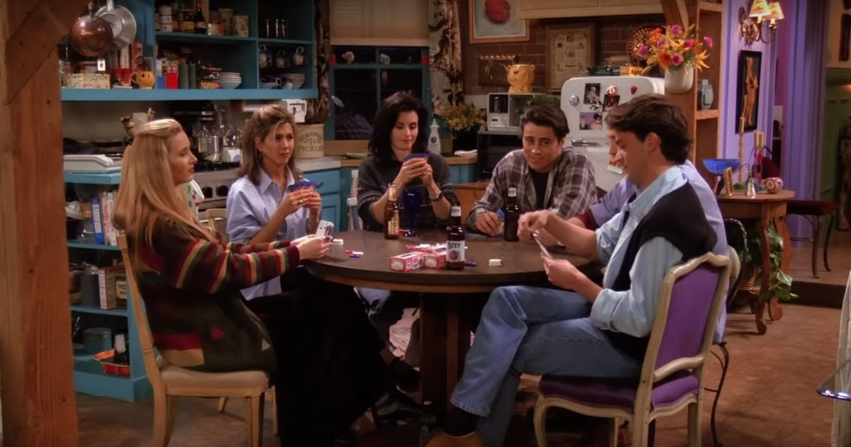 The cast of 'Friends' sit around a table playing poker in Monica's apartment.