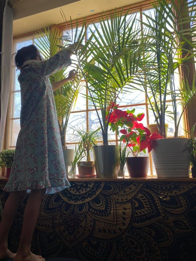 Tending to houseplants is one way kids are entertaining themselves during quarantine.