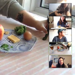 A Passover seder plate as seen through a zoom window. With the coronavirus pandemic, Jewish millennials are getting creative with how to host a passover seder over zoom.