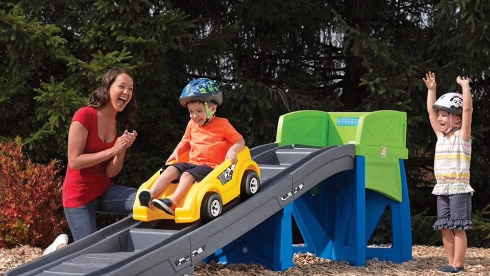 little boy going down a backyard roller coaster