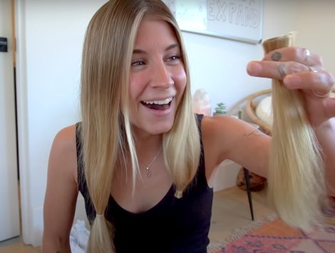 YouTuber Alyse Parker holds up inches of cut-off hair. Haircutting videos are trending in quarantine.