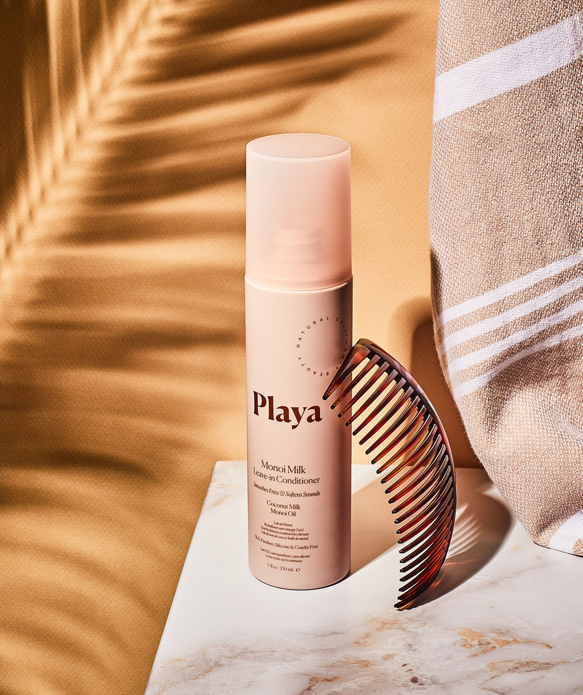 Playa's leave-in conditioner helps detangle, prime, and protect hair from heat.