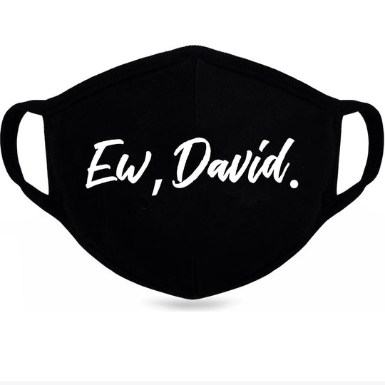 "Black mask with ""Ew, David"" printed on the front in bold, white lettering."