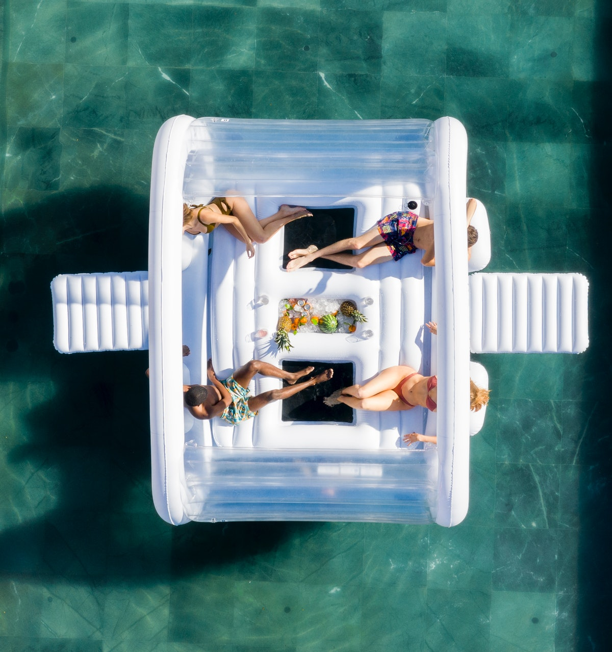 An aerial shot of a group of friends shows them hanging out in a pool on FUNBOY's Giant Dayclub pool...