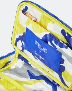 Supergoop!'s collab with MZ Wallace features a new blue and yellow makeup bag.