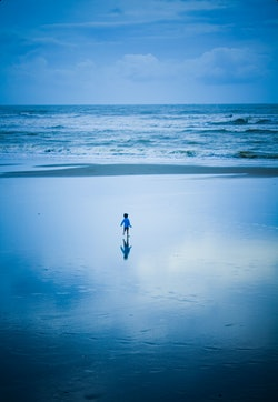 Toddler alone on a beach