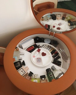 Use a decorative vanity as a makeup and skincare display idea