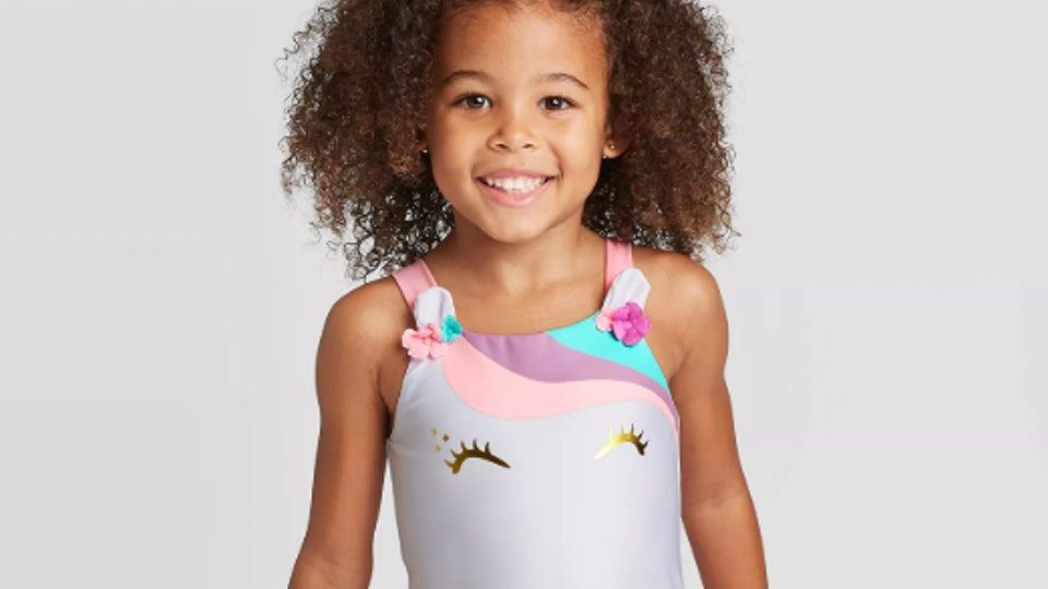 little girl wearing a unicorn bathing suit from target