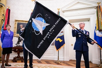 The official flag of the United States Space Force in the Oval Office of the White House in Washington, DC on May 15, 2020
