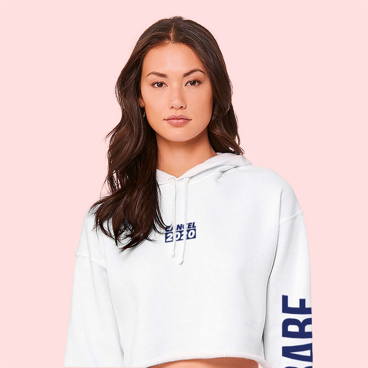 A young woman poses in a white sweatshirt from BABE Wine.