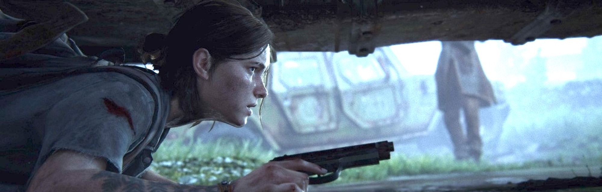 Ellie crouches beneath a car to evade enemies in 'The Last of Us Part II,' out June 19.