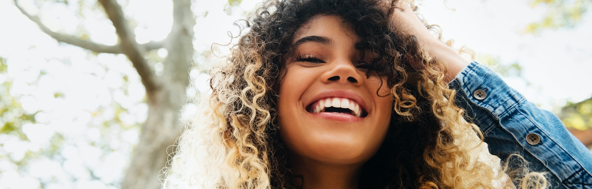 https://www.gettyimages.com/detail/photo/smiling-mixed-race-woman-with-hand-in-hair-royalty-free-image/700712243?adppopup=true&uiloc=thumbnail_similar_images_adp