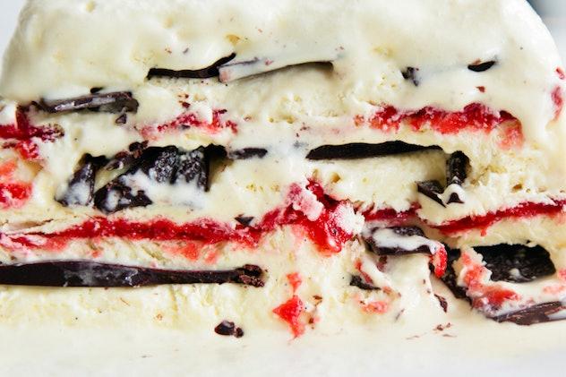 layers of dark chocolate and strawberries with vanilla semifreddo layering between.