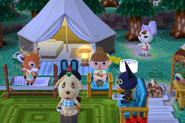 A group of villagers hangs out at a campsite at night in 'Animal Crossing: Pocket Camp.'