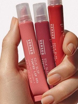 All three new shades of Versed's new Silk Slip Tinted Lip Oils.