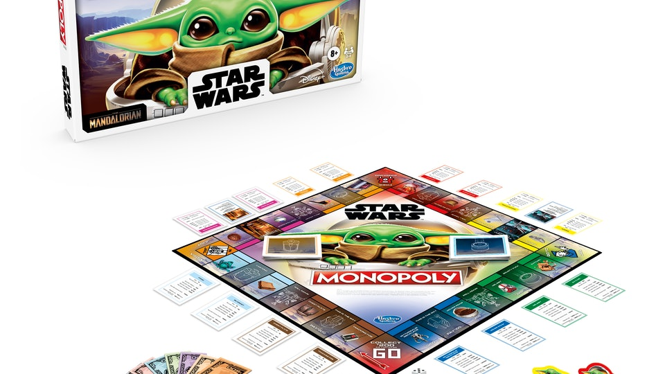 An image of a Monopoly board with the figure of The Child from The Mandalorian on the surface.