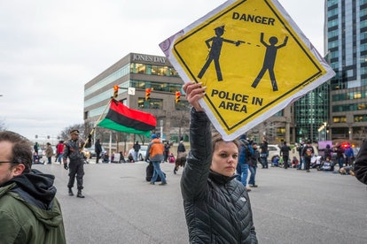 Protesters took to the street the day after a grand jury declined to indict Cleveland Police Officer...