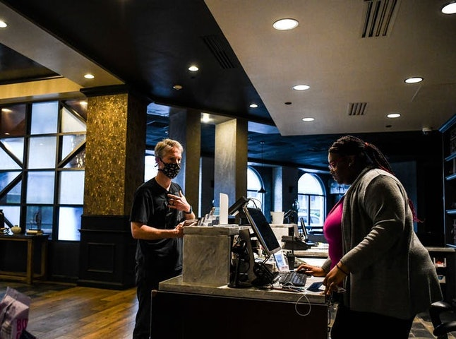 A tourist checks into a hotel in Savannah, Ga., on April 25, 2020, shortly after Georgia Gov. Brian Kemp lifted some social distancing measures.