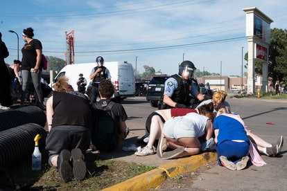 After police engaged protesters and injured a woman with a tear gas canister across from the city's ...