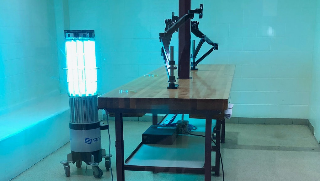 A robot emits high-intensity ultraviolet light in a booking room at the Kent County Jail in Grand Rapids, Michigan.