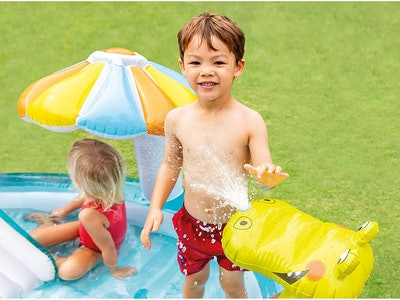kids playing in inflatable pool with slide