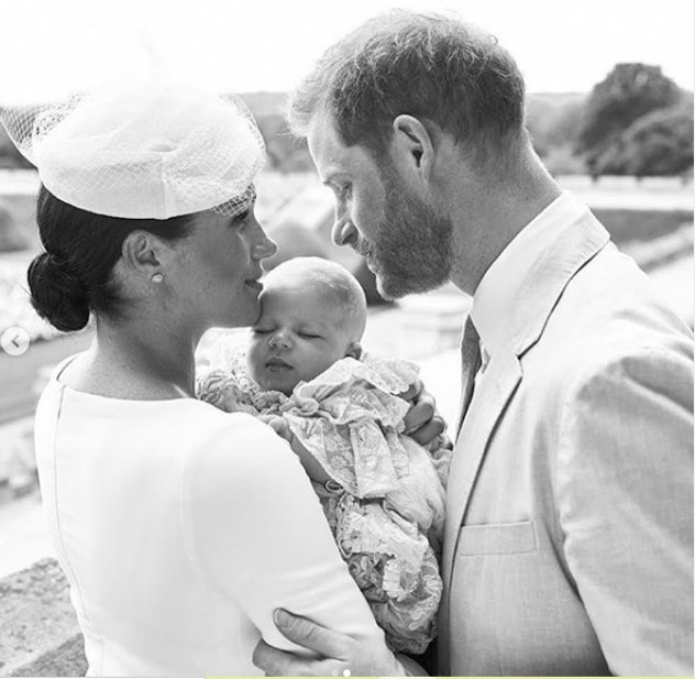 Prince Harry is devoted to baby Archie at his christening.