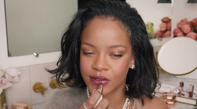 Rihanna applying lipstick in Fenty Beauty tutorial