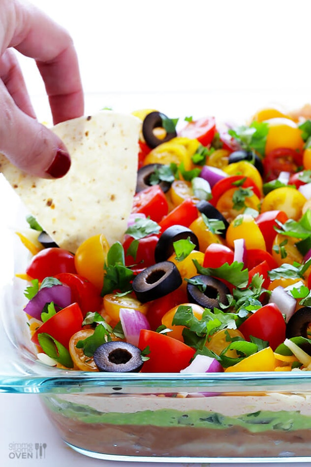 This recipe for 7 Layer Dip from Gimme Some Oven is a tasty summer dip to try.