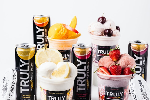 Truly Hard Seltzer and Tipsy Scoop's seltzer-infused ice cream comes in four different, fruity flavors and can be paired with real fruit.