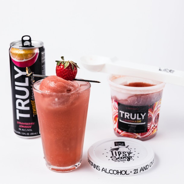 Truly Hard Seltzer and Tipsy Scoop's seltzer-infused ice cream comes in a strawberry flavor that can be scooped into a drink.