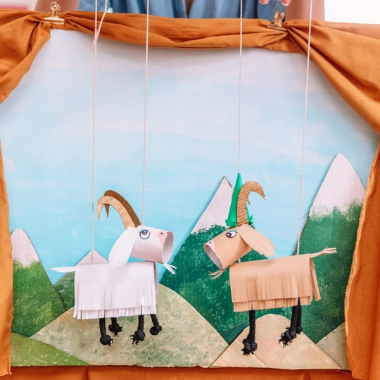 A lonely pair of paper goat marionettes on a mountain top.